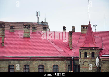 Fragment of a metal roof of the restored old multi-storey building in Lviv, Ukraine - Stock Photo