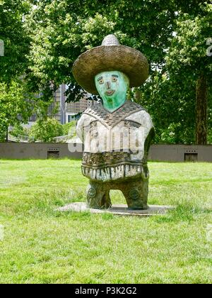 One of Rachid Khimoune's statues from the piece, 'Children of the World.' This one represents the country of Mexico. Bercy Park, Paris, France - Stock Photo