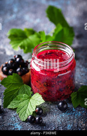 Black currant jam in jar - Stock Photo