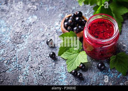 Black currant jam in jar - Stock Photo