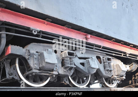 Black wheels of an old USSR locomotive. Vintage wheels of an old soviet freight railcar - Stock Photo