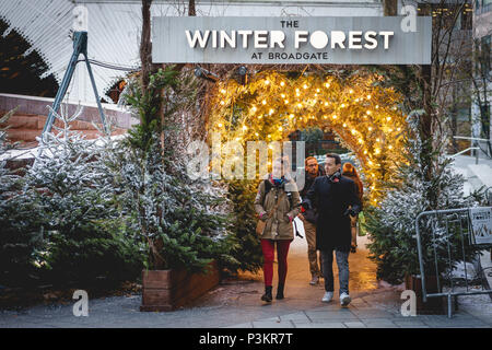 London, UK - November 2017. People in Exchange Square in Broadgate, where a Nordic-inspired forest called Winter Forest is installed at Christmas. - Stock Photo