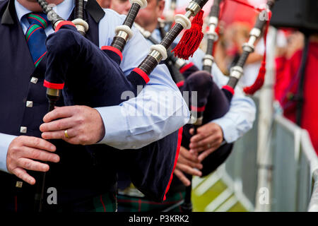 Aberdeen, Scotland - June 17, 2018: Massed pipe bands marching on the field at the Highland Games in Hazlehead Park, Aberdeen, Scotland - Stock Photo