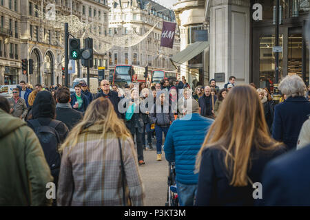 London, UK - November 2017. Decorated Regents Street crowded with people shopping for Christmas. Landscape format. - Stock Photo