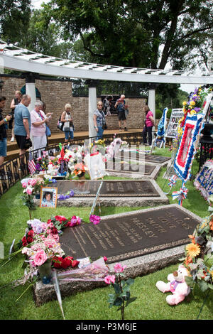 The grave of Gladys Presley, mother of singer Elvis Presley, at Graceland, on the 40th anniversary of his death, Memphis, Tennessee. - Stock Photo