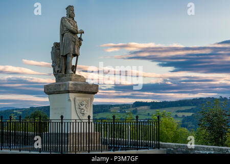 Dawn over Robert the Bruce statue at entrance to Stirling Castle, Stirling, Scotland, UK - Stock Photo