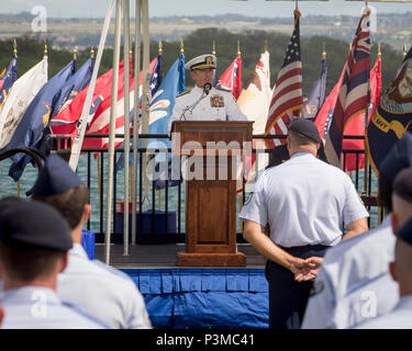 Adm. Harry B. Harris, Jr., U.S. Pacific Command commander, provides remarks during an assumption-of-command ceremony at Joint Base Pearl Harbor-Hickam, Hawaii, July 12, 2016. Harris and Gen. David L. Goldfein, U.S. Air Force Chief of Staff, presided over the ceremony in which Gen. Terrence J. O'Shaughnessy assumed command of Pacific Air Forces. (U.S. Air Force photo by Capt. Raymond Geoffroy) - Stock Photo