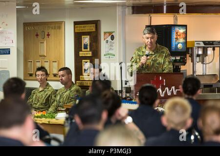 160712-N-CV785-039 SOUTH CHINA SEA (July 12, 2016) Commander, Australian Contingent for Pacific Partnership 2016, Lt. Col. Michael Abrahams addresses crew members during the celebration for the Royal Australian Army Medical Corps 114th birthday, aboard hospital ship USNS Mercy (T-AH 19). Mercy, which is deployed in support of Pacific Partnership 2016, is en route to its third mission stop in Da Nang, Vietnam. Upon arrival, partner nations will work side-by-side with local military and non-government organizations to conduct cooperative health engagements, community relation events and subject  - Stock Photo