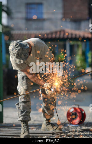 U.S. Air Force Senior Master Sgt. Todd Butcher, New Jersey Air National Guard civil engineer, uses an angle grinder with an abrasive disc to cut a reinforcing bar in Vau i Dejës, Albania on July 11, 2016. The 177th Fighter Wing civil engineers were working on Humanitarian and Civic Assistance renovation projects at a local medical clinic during their two week long deployment for training. New Jersey and Albania are paired under the National Guard's State Partnership Program and are a proven partnership built upon shared values, experiences and vision. (U.S. Air National Guard photo by Master S - Stock Photo