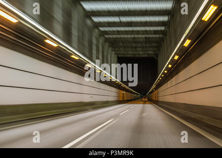 Driving a car through the tunnel between Denmark and Sweden, blurred motion. May 11. 2018 - Stock Photo