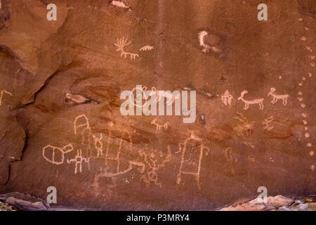 Prehistoric Ancestral Puebloan petroglyphs in San Juan County in southeastern Utah, United States - Stock Photo