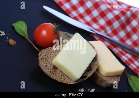 Slices of bread with cheese on top of them - Stock Photo