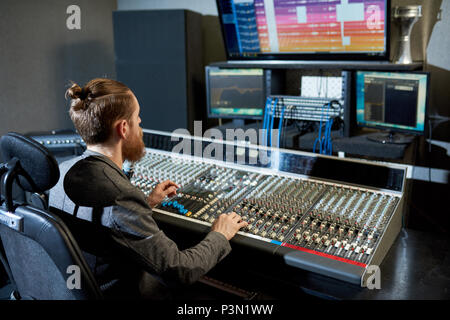 Man mixing and creating music - Stock Photo