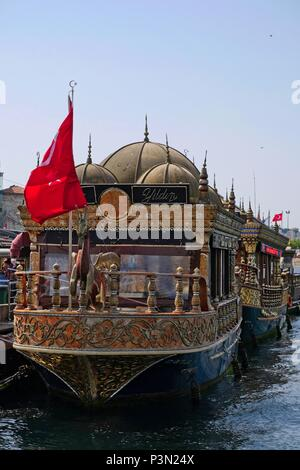 ISTANBUL, TURKEY - MAY 24 : View of Chinese floating restaurants along the Bosphorus in Istanbul Turkey on May 24, 2018. Two unidentified people - Stock Photo