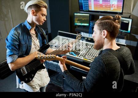 Coworking musicians in recording studio - Stock Photo
