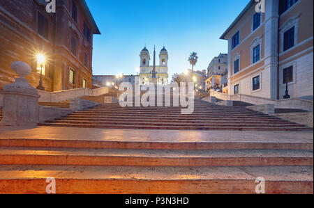 Monumental staircase Spanish Steps and and Trinita dei Monti church, evening view from Piazza di Spagna in Rome, Italy - Stock Photo