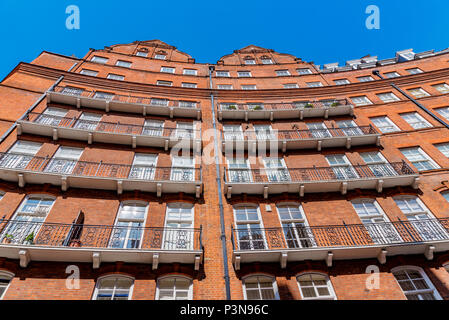 LONDON, UNITED KINGDOM - MAY 06: Traditional British architecture of luxury apartments in Kensington on May 06, 2018 in London - Stock Photo