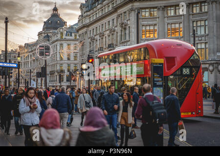 London, UK - November 2017. Decorated Oxford Circus crowded with people shopping for Christmas. Landscape format. - Stock Photo