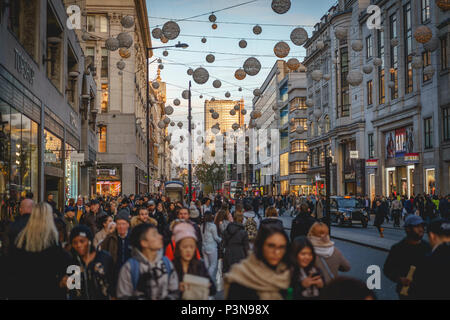 London, UK - November 2017. Decorated Oxford Street crowded with people shopping for Christmas. Landscape format. - Stock Photo