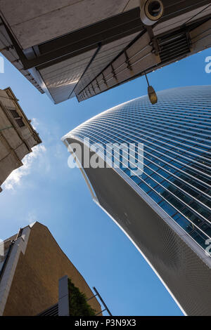 looking up at the tall multi-storey buildings in the city of London financial district on a bright summers day with blue skies. walkie talkie. - Stock Photo