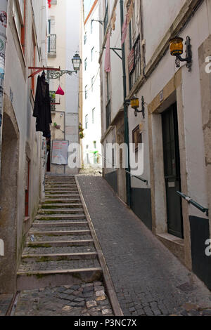 Typical street in Alfama district, Lisbon, Portugal - Stock Photo