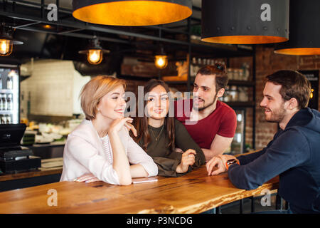 Friends Meeting in bar with loft interior - Stock Photo