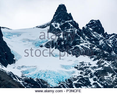 Zoomed view of crevices of glacier ice on Paine Grande mountain, Torres del Paine National Park, Patagonia, Chile, South America - Stock Photo