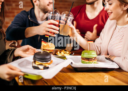 Leisure, celebration, Fastfood consumption, people and holidays concept. - Stock Photo