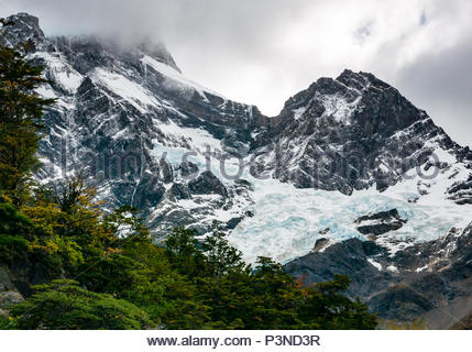 Zoomed view of blue glacier ice at top of mountain in French Valley, Torres del Paine National Park, Patagonia, Chile, South America - Stock Photo