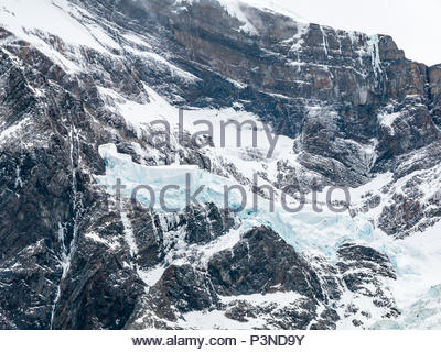 Zoomed view of hanging glacier ice in French Valley, Torres del Paine National Park, Patagonia, Chile, South America - Stock Photo