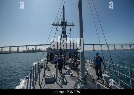 160715-N-DJ750-026   SAN DIEGO (July 15, 2016) Avenger-class Mine Countermeasures Ship USS Champion (MCM 4) transits San Diego bay during the Southern California portion of Rim of the Pacific 2016. Twenty-six nations, more than 40 ships and submarines, more than 200 aircraft and 25,000 personnel are participating in RIMPAC from June 30 to Aug. 4, in and around the Hawaiian Islands and Southern California. The world's largest international maritime exercise, RIMPAC provides a unique training opportunity that helps participants foster and sustain the cooperative relationships that are critical t - Stock Photo