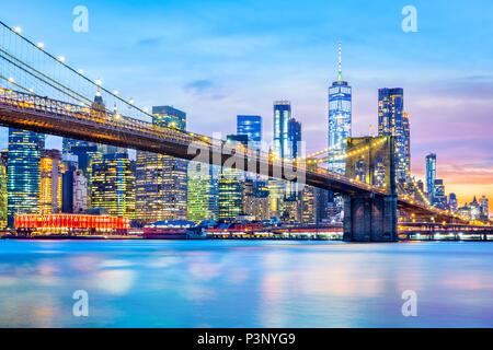 Brooklyn Bridge and the Lower Manhattan skyline at dusk - Stock Photo