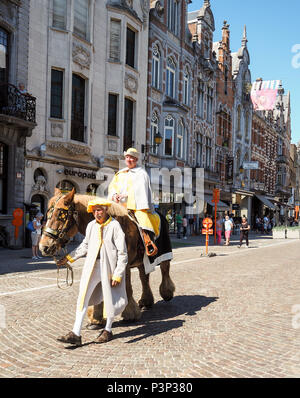 Mechelen, Belgium - May 2018: Two actors dressed in traditional costumes in the religious Hanswijk procession - Stock Photo