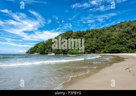 The South China Sea laps the beach in Kota Kinabalu on Borneo, Malaysia - Stock Photo