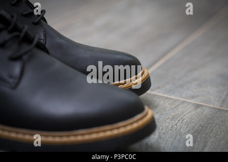 Classic stylish men's shoes closeup on gray background - Stock Photo