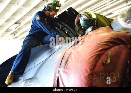 160713-N-TU910-099   PACIFIC OCEAN (July 13, 2016) – Lance Cpl. Vanessa Guerrero, left, from Los Angeles, California, and Cpl. Kevoy Brooks, right, from Paterson, New Jersey, of the 11th Marine Expeditionary Unit (MEU), perform maintenance on an AV-8B Harrier aboard the amphibious assault ship USS Makin Island (LHD 8). Makin Island is conducting integrated training with Amphibious Squadron Five and the 11th MEU in preparation for an upcoming deployment. (U.S. Navy photo by Mass Communication Specialist 3rd Class Abby Rader/Released) - Stock Photo