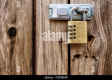 Padlock on a wooden door - Stock Photo