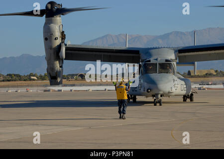 160711-N-IL474-125 SOUDA BAY, Greece (July 11, 2016) Aviation Boatswain's Mate (Equipment) 3rd Class Adrian Brown, assigned to U.S. Naval Support Activity Souda Bay Air Operations Department Transient Line Division, directs an MV-22 Osprey following its arrival.  NSA Souda Bay enables the forward operations and responsiveness of U.S. and allied forces in support of Navy Region, Europe, Africa and Southwest Asia's mission to provide services to the Fleet, Fighter, and Family. (U.S. Navy photo by Heather Judkins/Released) - Stock Photo