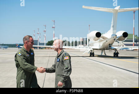 Brig. Gen. Jon T. Thomas, 86th Airlift Wing commander, greets Lt. Col. Derek Gallagher, 76th Airlift Squadron commander, before taking off for his final flight as the 86th AW commander July 19, 2016, at Ramstein Air Base, Germany. Thomas has served in the 86th AW for one year and will be moving on to Scott Air Force Base, Illinois. (U.S. Air force photo/Airman 1st Class Lane T. Plummer) - Stock Photo