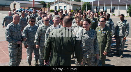 """Airmen approach Brig. Gen. Jon T. Thomas, 86th Airlift Wing commander, after his """"fini flight"""" July 21, 2016, at Ramstein Air Base, Germany. Airmen traditionally come out to greet their commanders after their final flight. (U.S. Air Force photo/Airman 1st Class Lane T. Plummer) - Stock Photo"""