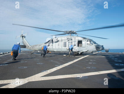 160720-N-IK388-003  PACIFIC OCEAN (July 20, 2016)-- Sailors assigned to amphibious dock landing ship USS Pearl Harbor (LSD 52) perform chock and chain duties during flight quarters as a part of the Southern California portion of Rim of the Pacific 2016. Twenty-six nations, more than 40 ships, five submarines, 200 aircraft and 25,000 personnel are participating in the biennial exercise. RIMPAC, the world's largest international maritime exercise, is designed to foster and sustain cooperative relationships to ensure the safety of sea lanes and security of the world's oceans. RIMPAC 2016 is the 2