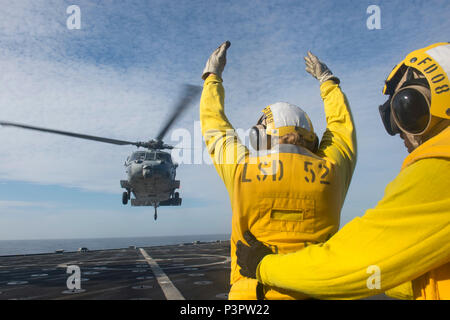 160720-N-IK388-023  PACIFIC OCEAN (July 20, 2016)-- Boatswain's Mate 3rd Class Rebecca Horsman, assigned to amphibious dock landing ship USS Pearl Harbor (LSD 52), performs landing signalman duties during flight quarters as a part of the Southern California portion of Rim of the Pacific 2016. Twenty-six nations, more than 40 ships, five submarines, 200 aircraft and 25,000 personnel are participating in the biennial exercise. RIMPAC, the world's largest international maritime exercise, is designed to foster and sustain cooperative relationships to ensure the safety of sea lanes and security of
