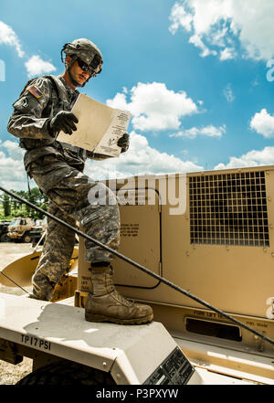 U.S. Army Sgt. Adam Lamb, a generator mechanic assigned to Echo Company, 427th Brigade Support Battalion, New York Army National Guard, works on a generator at the Joint Readiness Training Center, Ft. Polk, La., July 26, 2016. Approximately 3,000 Soldiers from New York joined 2,000 other state Army National Guard units, active Army and Army Reserve troops as part of the 27th Infantry Brigade Combat Team task force. The Soldiers are honing their skills and practicing integrating combat operations ranging from infantry troops engaging in close combat with an enemy to artillery and air strikes, J - Stock Photo