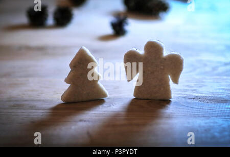 .gingerbread figures Christmas tree and an angel on the wooden t - Stock Photo