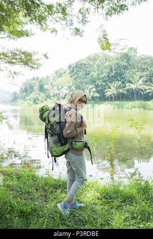 woman hiker hiking on mountain trail - Stock Photo