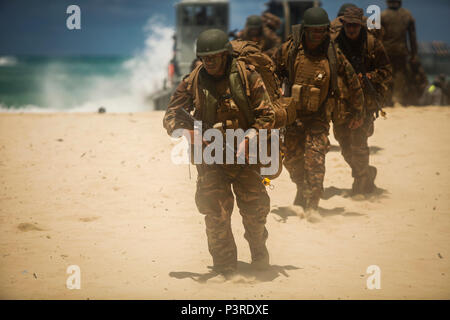 160731-M-CP369-1036 MARINE CORPS BASE, HAWAII (July 30, 2016) - His Majesty's Royal Armed Forces of Tonga conduct an amphibious landing during Rim of the Pacific 2016 at Marine Corps Training Area Bellows, Hawaii, 30 July. The crafts landed troops from 2nd Battalion, Royal Australian Regiment, Provisional Marine Expeditionary Brigade-Hawaii, which came from HMAS Canberra to the beach during a coordinated amphibious assault with forces from Battalion Landing Team 2nd Battalion, 3rd Marines landing on Pyramid Rock Beach from USS San Diego.  The landings are a part of the free-play scenario phase - Stock Photo