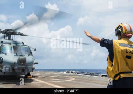 PACIFIC OCEAN (July 20, 2016) - Boatswain's Mate 2nd Class Cheyenne Strausser, from Pottsville, Pennsylvania guides an MH-60R Seahawk from the 'Raptors' of Helicopter Maritime Strike Squadron (HSM) 71 during Rim of the Pacific 2016. Twenty-six nations, 40 ships and submarines, more than 200 aircraft and 25,000 personnel are participating in RIMPAC from June 30 to Aug. 4, in and around the Hawaiian Islands and Southern California. The world's largest international maritime exercise, RIMPAC provides a unique training opportunity that helps participants foster and sustain the cooperative relation