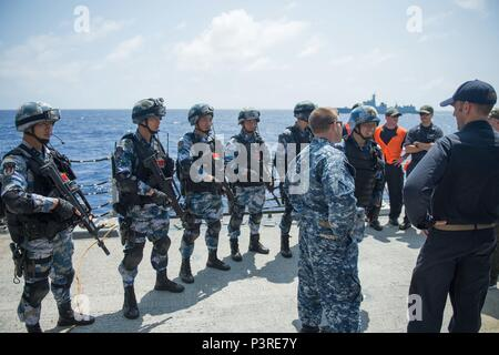 PACIFIC OCEAN (July 20, 2016) - Sailors from the guided-missile destroyer USS Stockdale (DDG 106) talk with Chinese navy sailors from the guided-missile destroyer Xian (153) after a VBSS (Visit, board, search, and seizure) exercise for Rim of the Pacific 2016. Twenty-six nations, 40 ships and submarines, more than 200 aircraft and 25,000 personnel are participating in RIMPAC from June 30 to Aug. 4, in and around the Hawaiian Islands and Southern California. The world's largest international maritime exercise, RIMPAC provides a unique training opportunity that helps participants foster and sust