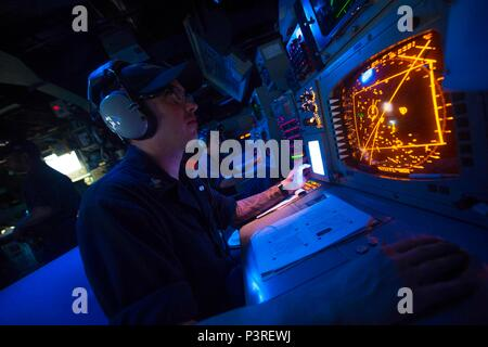 160722-N-BL607-065    ARABIAN GULF (July 22 2016) – Operations Specialist 2nd Class Sean Wilcox, assigned to the guided-missile cruiser USS Monterey (CG 61), conducts range clearance for the Griffin Missile live fire exercise. Monterey, deployed as part of the Eisenhower Carrier Strike Group, is supporting maritime security operations and theater security cooperation efforts in the U.S. 5th Fleet area of operations.  (U.S. Navy photo by Mass Communication Specialist 2nd Class William Jenkins/Released) - Stock Photo