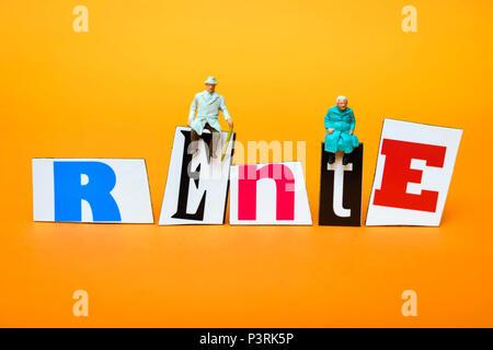 Miniature figures on the lettering Pension, Miniaturfiguren auf dem Schriftzug Rente - Stock Photo